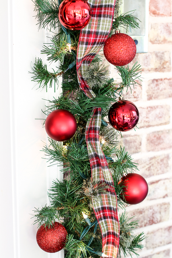 it has a rustic feel but can easily glam up with some shiny ornaments plastic ornaments are great for the porch