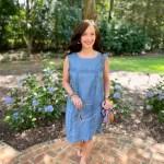 lady in blue dress on walkway