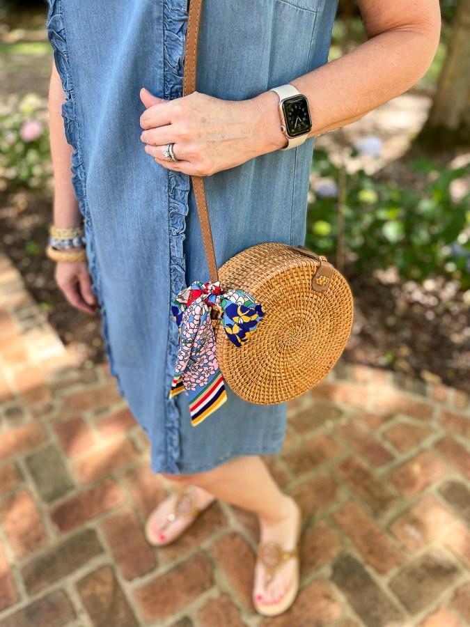 woman holding a wicker purse