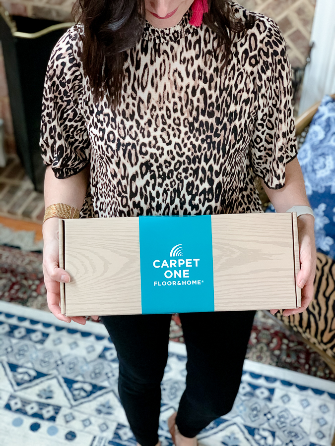 girl holding a box of carpet one samples