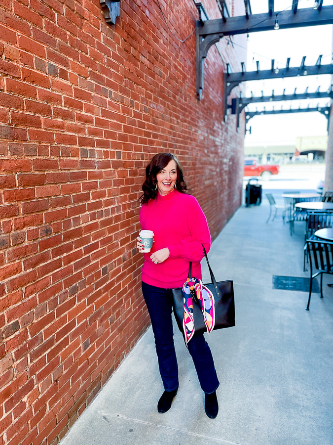 woman by brick wall
