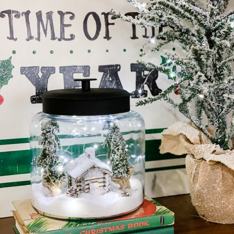christmas scene in a cookie jar with fairy lights