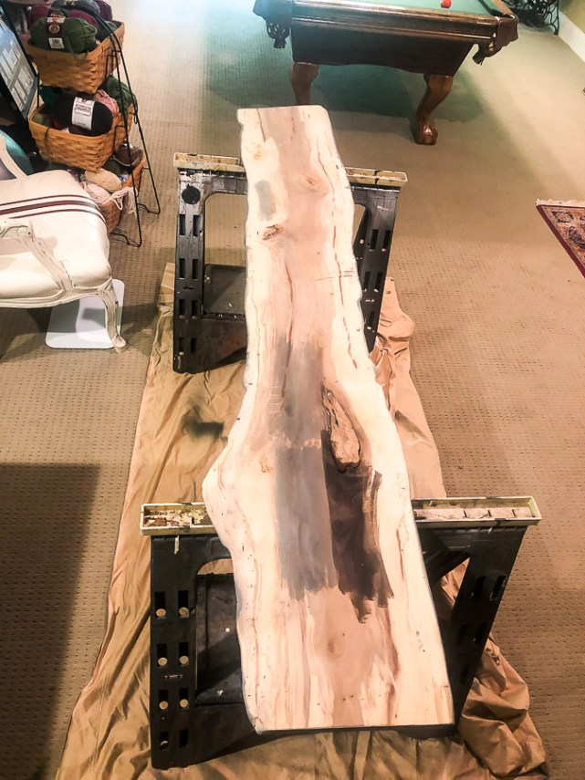 long piece of flat wood for a sign