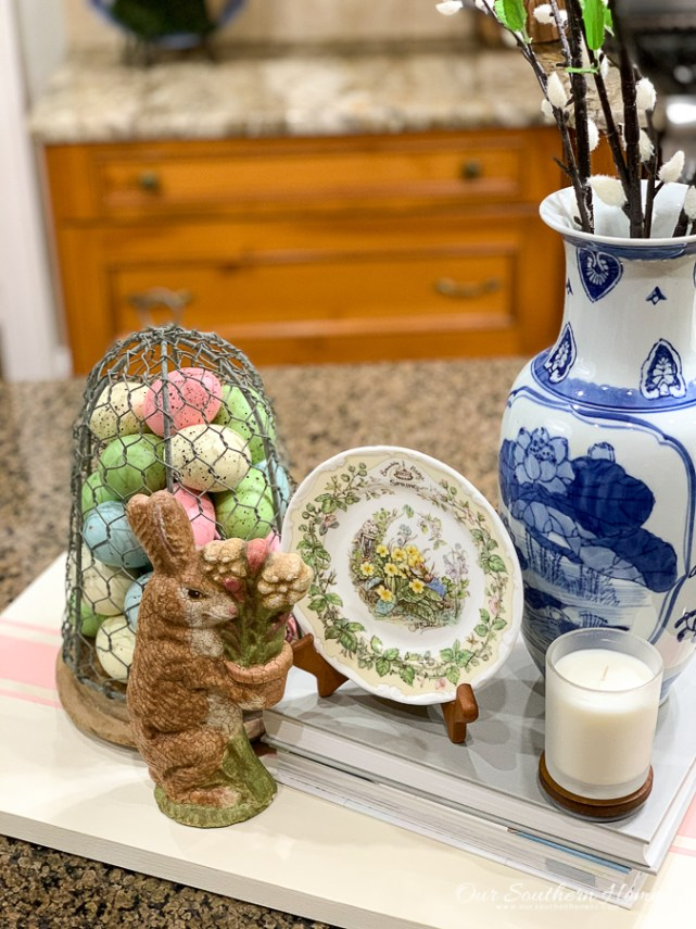 spring vignette with flowers and books