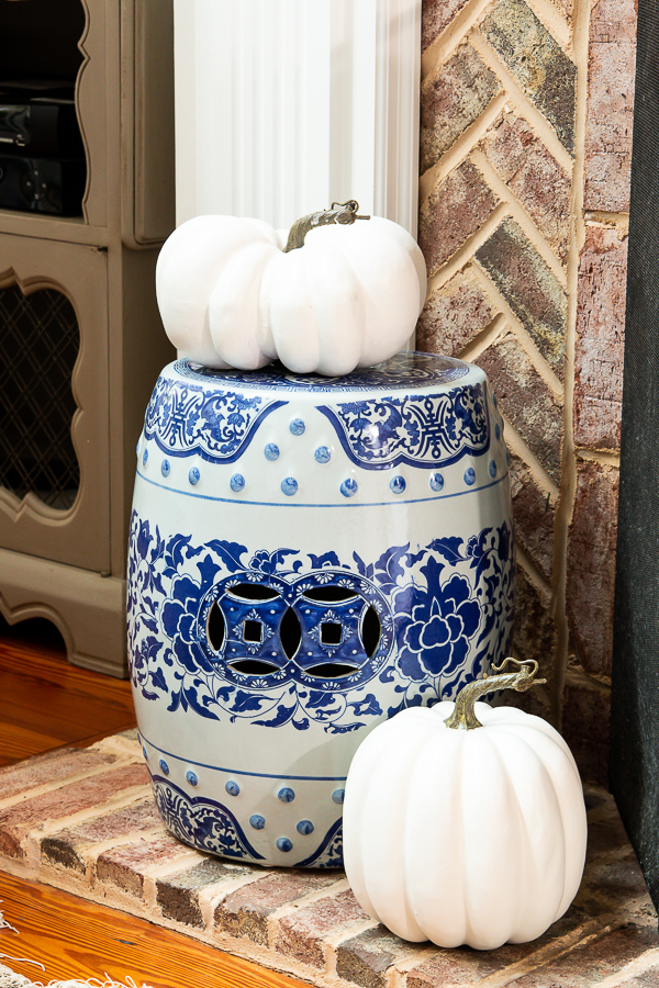 chinoiserie garden stool with pumpkins
