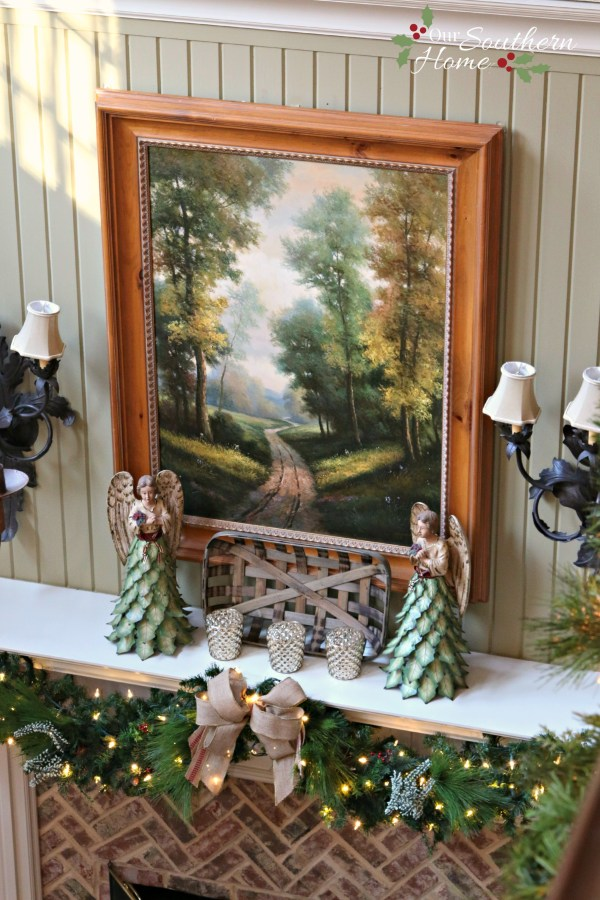 French Country Christmas mantel featuring large PEACE letters and gorgeous metal angels by Our Southern Home