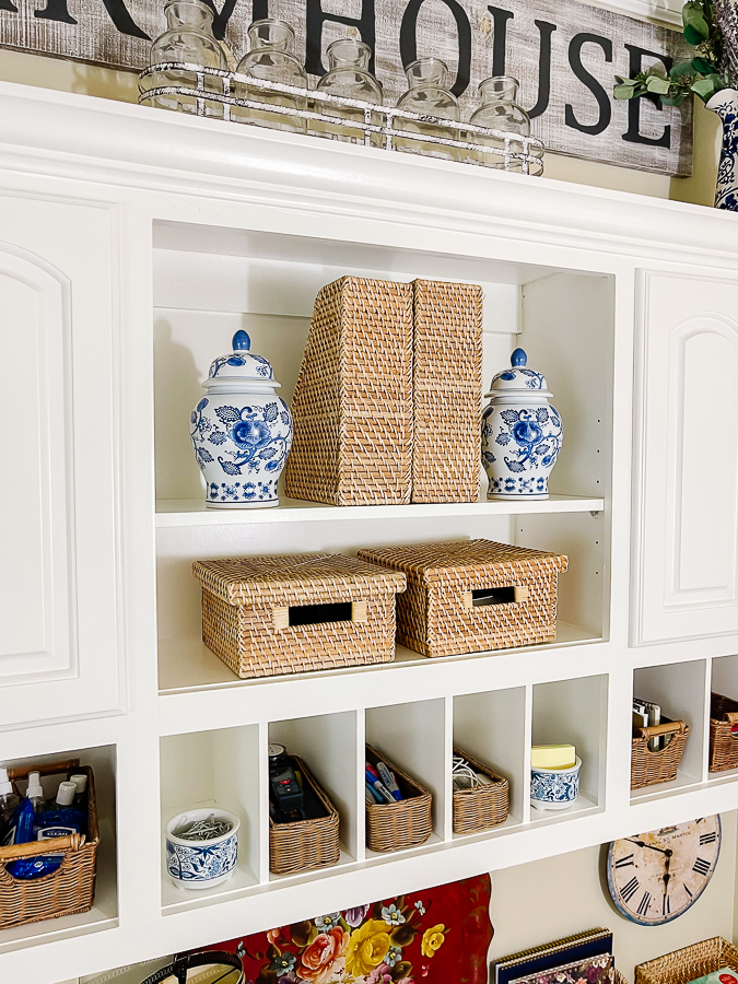 blue and white vases on shelf with baskets