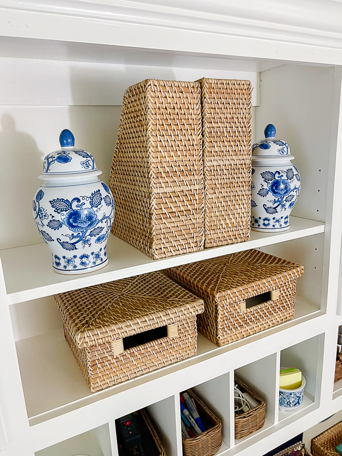 open shelving with blue and white vase