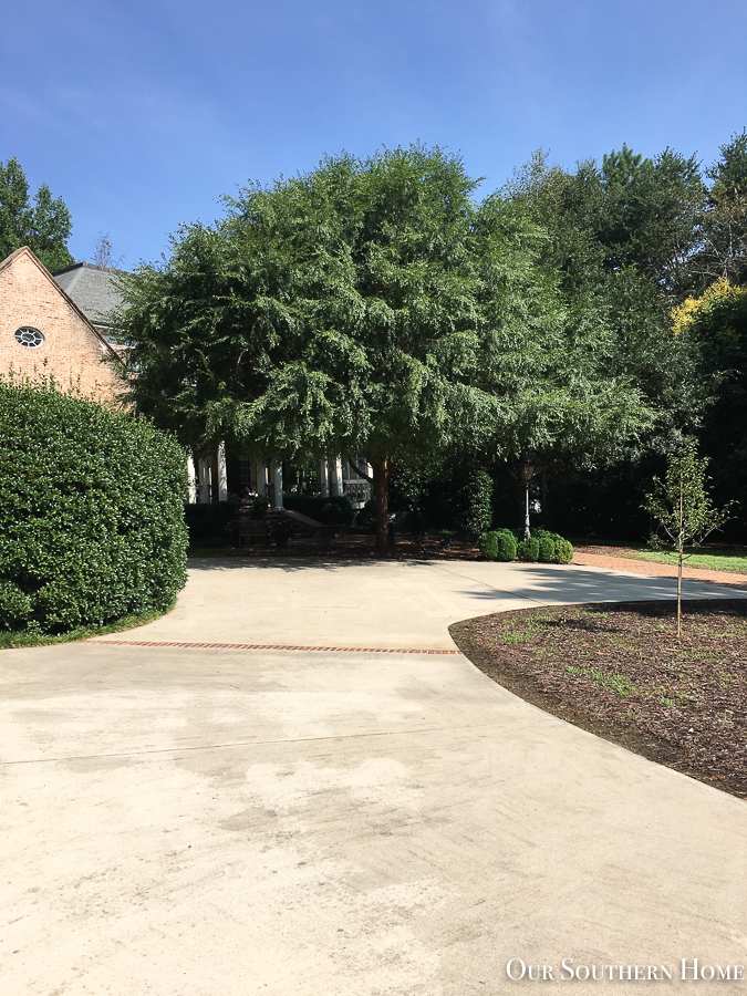 driveway with brick house
