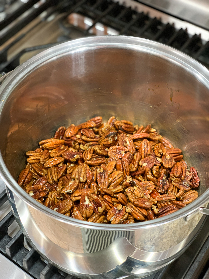 pecans on the stove in a pot