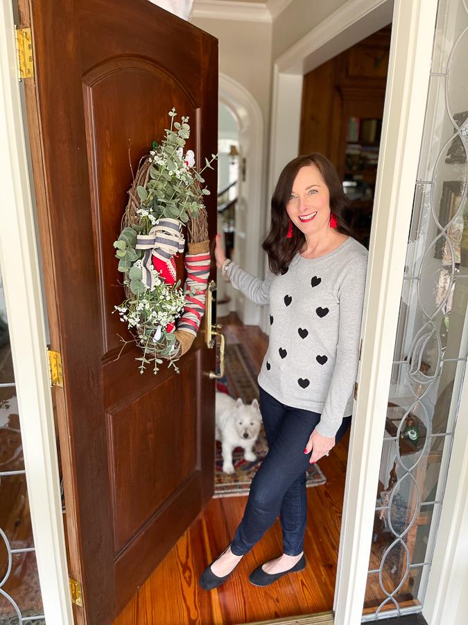 woman standing in doorway with dog