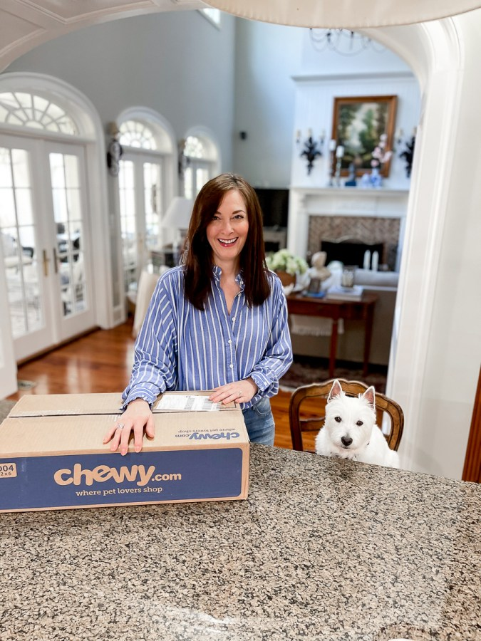 woman with dog and Chewy box