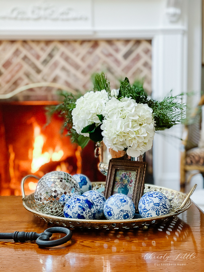 winter floral arranging by fire