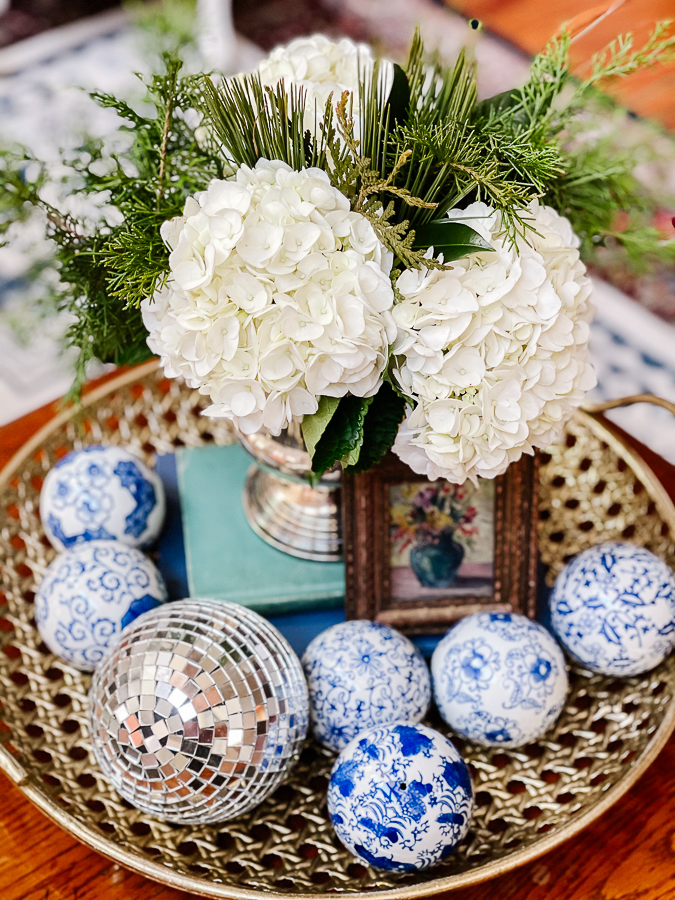 winter floral arranging with blue and white porcelain on a brass tray
