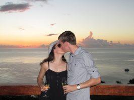 sharing a kiss at sunset