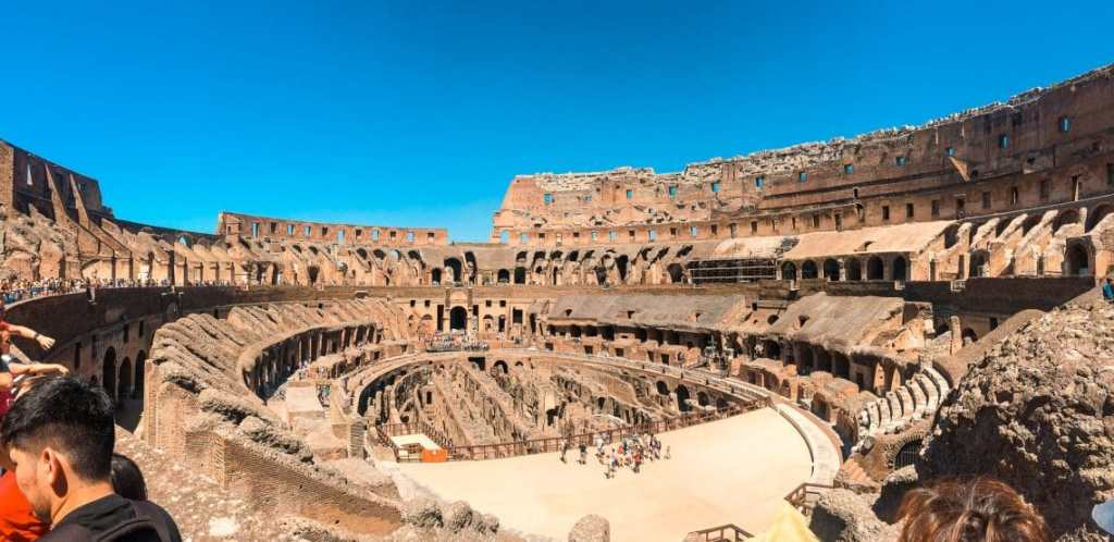 A spectacular panorama photo inside the Colosseum showing the amazing architecture of the amphitheater.