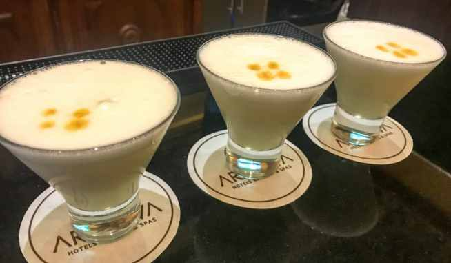 Enjoying pisco sours at our boutique hotel in Cusco - Aranwa Cusco Boutique Hotel