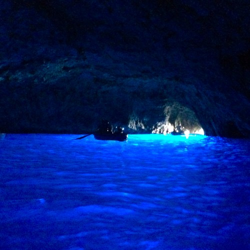 Enjoying a romantic tour at Capri, Italy's Blue Grotto.