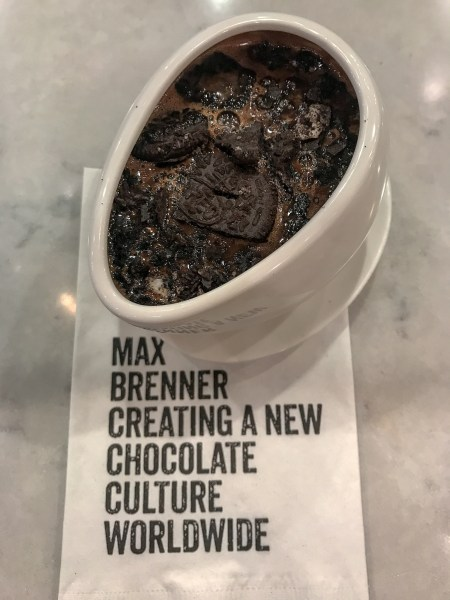 "Max Brenner has perfected hot chocolate by creating a Hugmug. It allows you to enjoy hot chocolate perfectly by using bth hands to keep them warm as you ""hug"" it."
