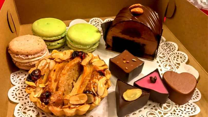 A variety of European and American desserts (macarons, apple pie, chocolate cake, and truffles) from Sucrose bakery in St. Charles, MO.