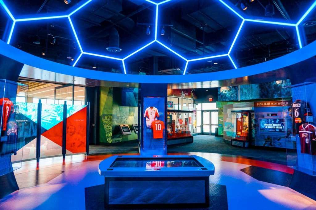 A pano of the Soccer Hall of Fame gallery with a neon blue soccer ball on the ceiling.