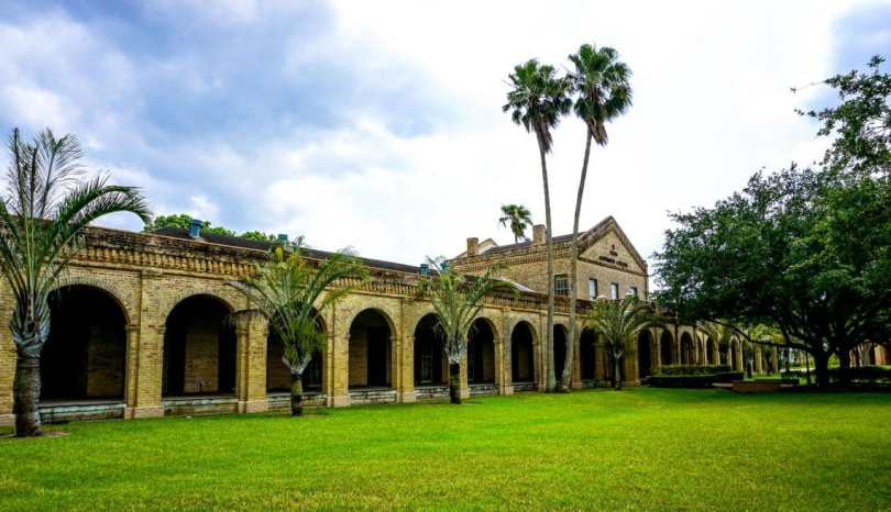 A part of Fort Brown which is within The University of Texas Rio Grande Valley's campus. A side view of one of the oldest standing buildings with beautiful archways.