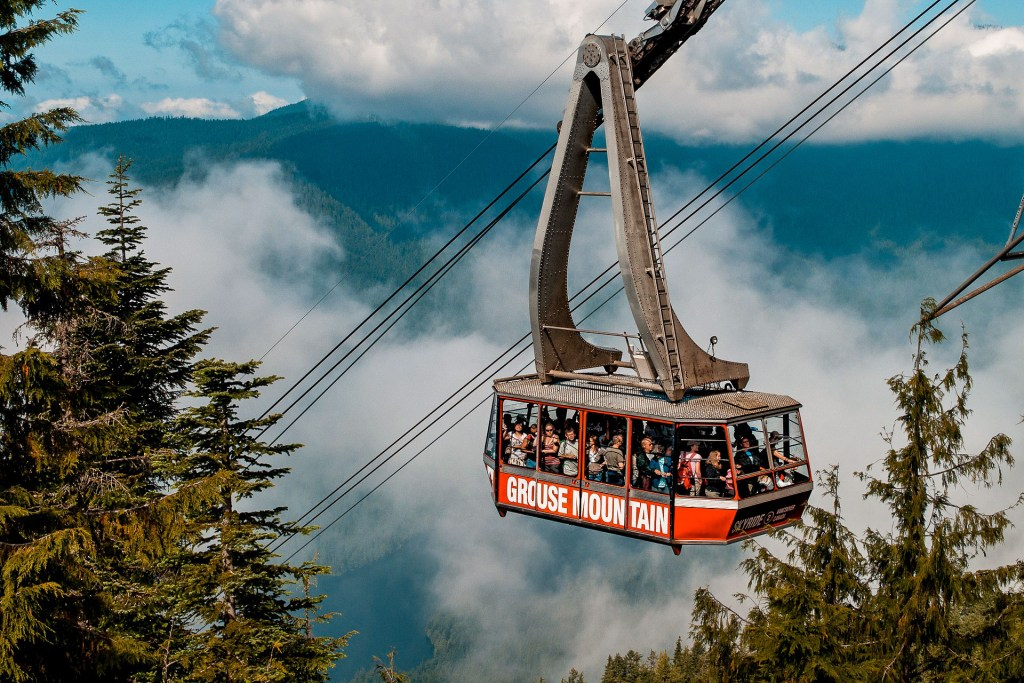 A cable car full of people going up to Grouse Mountain - one of the best activities to include in a Vancouver itinerary.