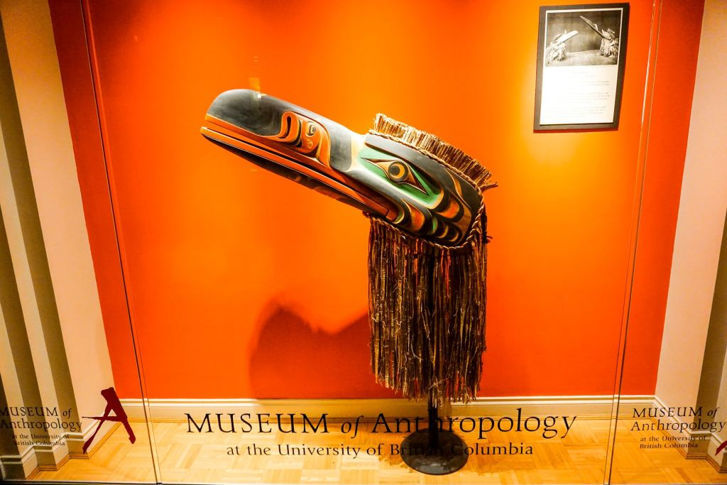 A window display of a First Nations art of a bird. This is inside the Listel Hotel on the Museum Level.
