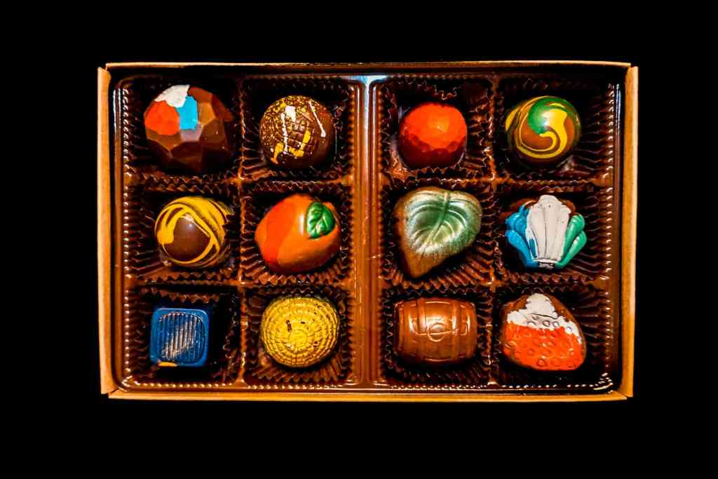 A box full of colorful chocolate truffles from Goodies Texas.