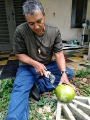 Cutting and scooping out the gourd after carving.