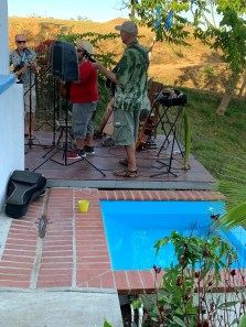Band playing on stage next to small infinity wade pool