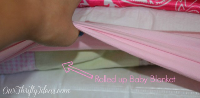 Add a Rolled Up Blanket under the fitted sheet to keep your child from rolling out of bed at night