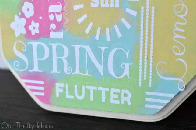 a cute tie-dye spring plaque made using the new Cricut Explore machine