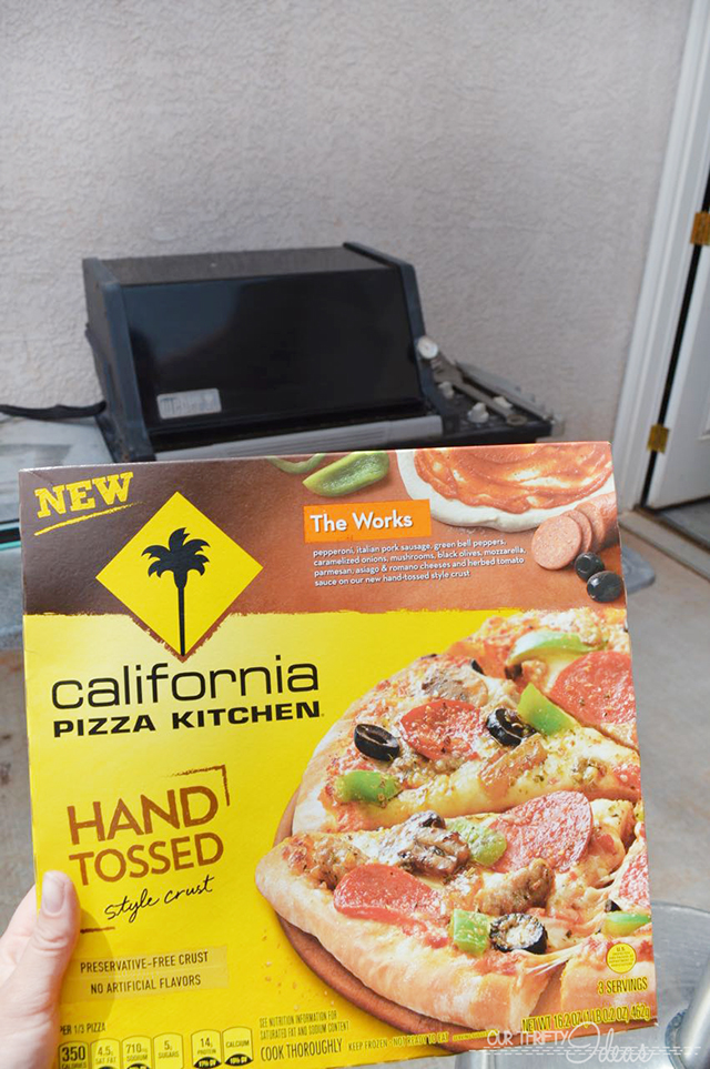cooking CPK pizza on a grill