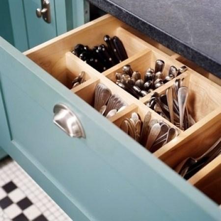 Using a deep drawer to store your utensils is a fun idea.