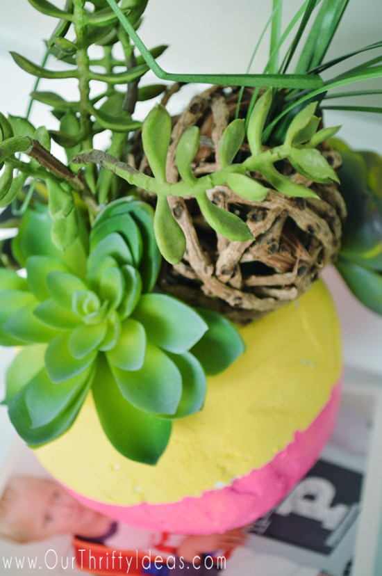 These faux planters are so cute. Can you believe they are made from foam balls and faux succulents? Creative