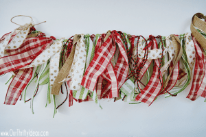 Using some coordinating Christmas ribbon to create this beautiful garland that can hang anywhere. Customize it to whatever length or color you need!