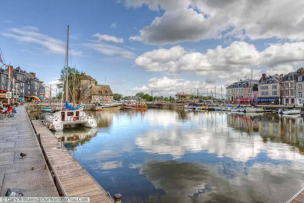 A view of the harbour featuring The Lieutenancy & carousel in the distance, Honfleur, France