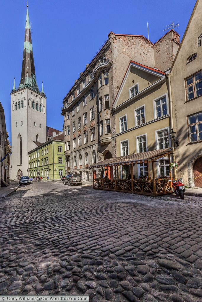 A view of St. Olav's Church and Tower and the cobbled streets of Tallinn.