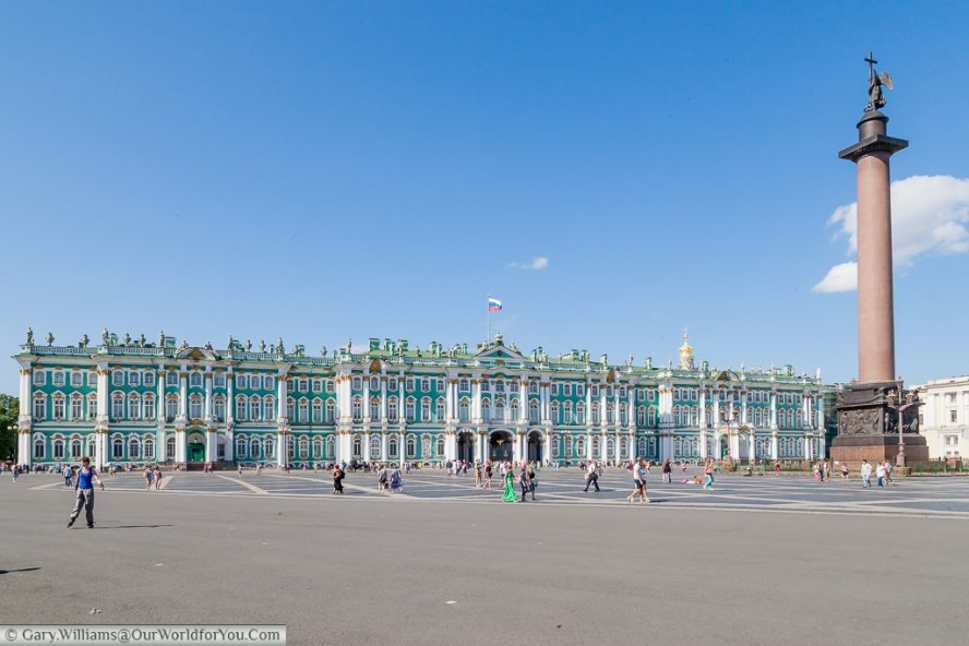 A view across Palace Square to the Hermitage Museum, with the Alexander Column on the right., St Petersburg, Russia