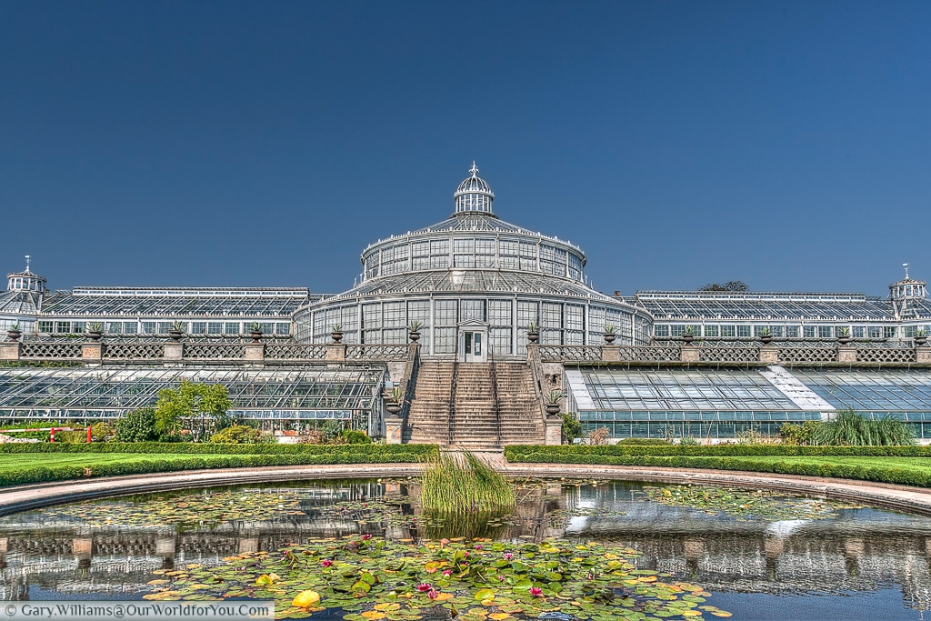 Overlooking a pond to one of the wonderful glasshouses at the Botanical gardens, Copenhagen, Denmark
