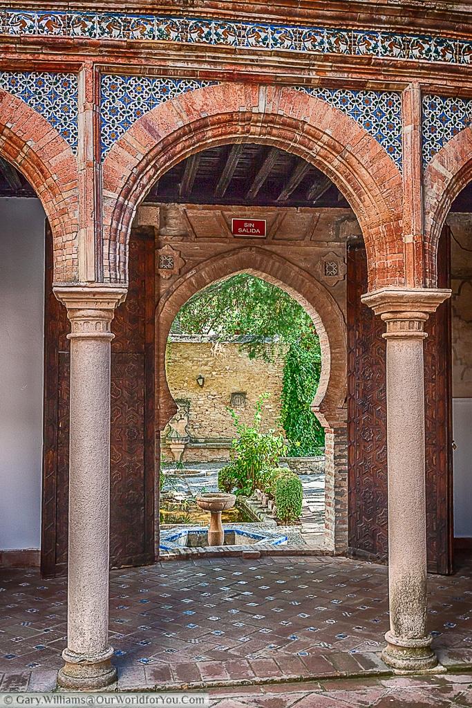 An arch leading to the garden in the Palacio de Mondragón, Ronda, Spain