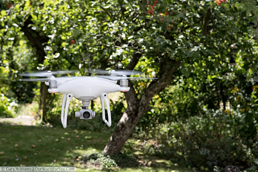 A DJI Phantom 4 Drone in a hover