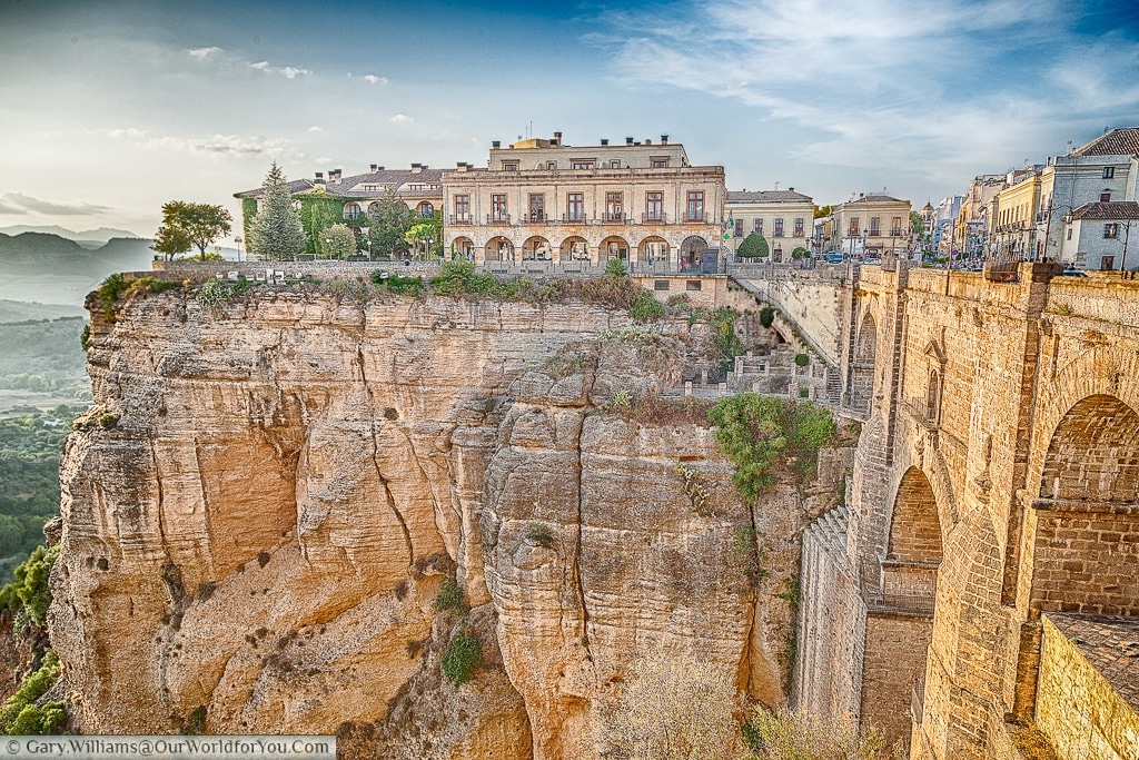 A view of the Parador de Ronda, with the Puente Nuevo spanning the gorge in Ronda, Spain