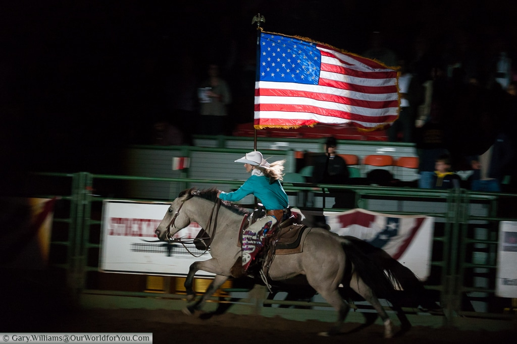 The Stars & Stripes being proudly flowin in the Stockyards Championship Rodeo, Fort Worth, Texas