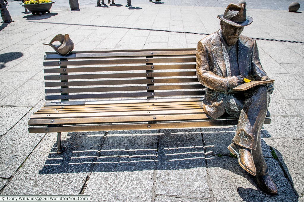 A monument to Antoni Gaudi on a bench, León, Spain