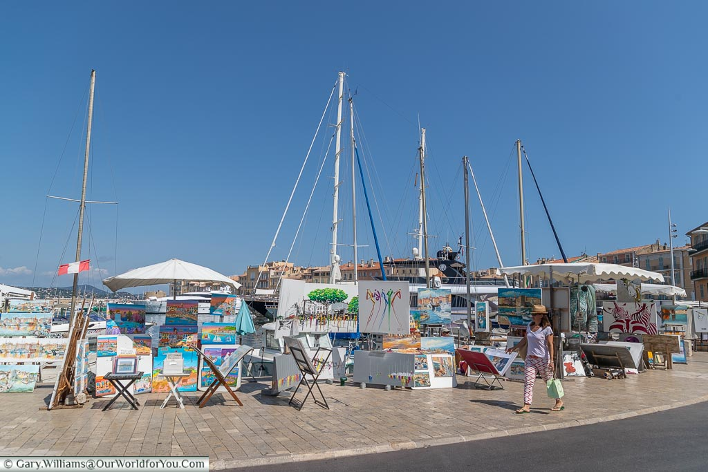 Artists along the quayside, St Tropez, France