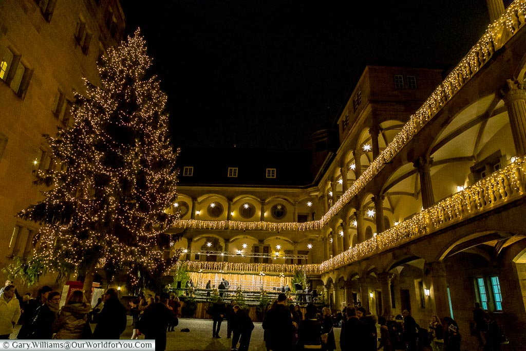 Inside Alten Schloss with its decorated Christmas Tree and balconies.