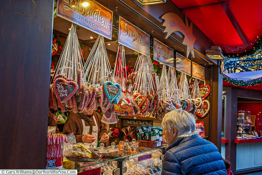 Carefully selecting the Lebkuchen hearts at the Christmas Market. Cologne, Germany