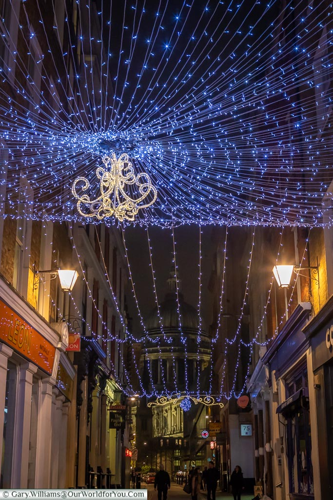 Lights over Bow Lane, St Paui's Catherdral in the distance, London at Christmas, UK